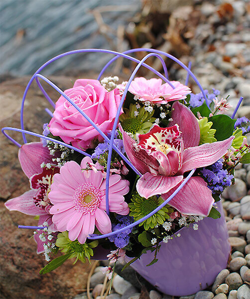 Floral bag containing pink flowers