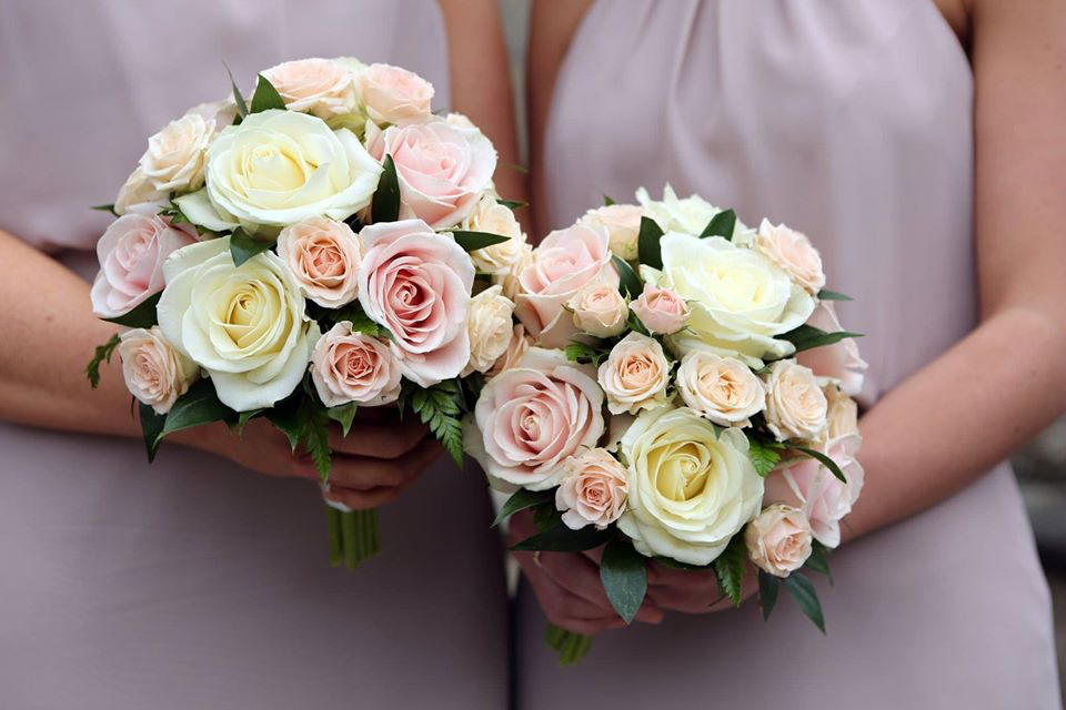 Pink and yellow roses for bridal party bouqet