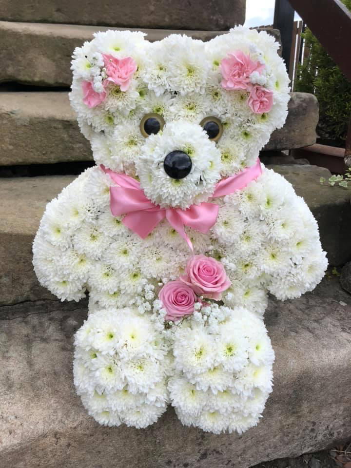 teddy bear floral tribute using white and pink flowers