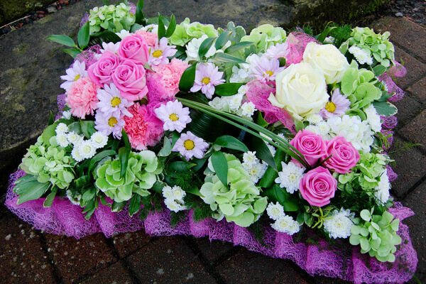 Pink and white floral tribute