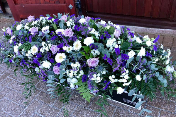 Purple and white floral tribute
