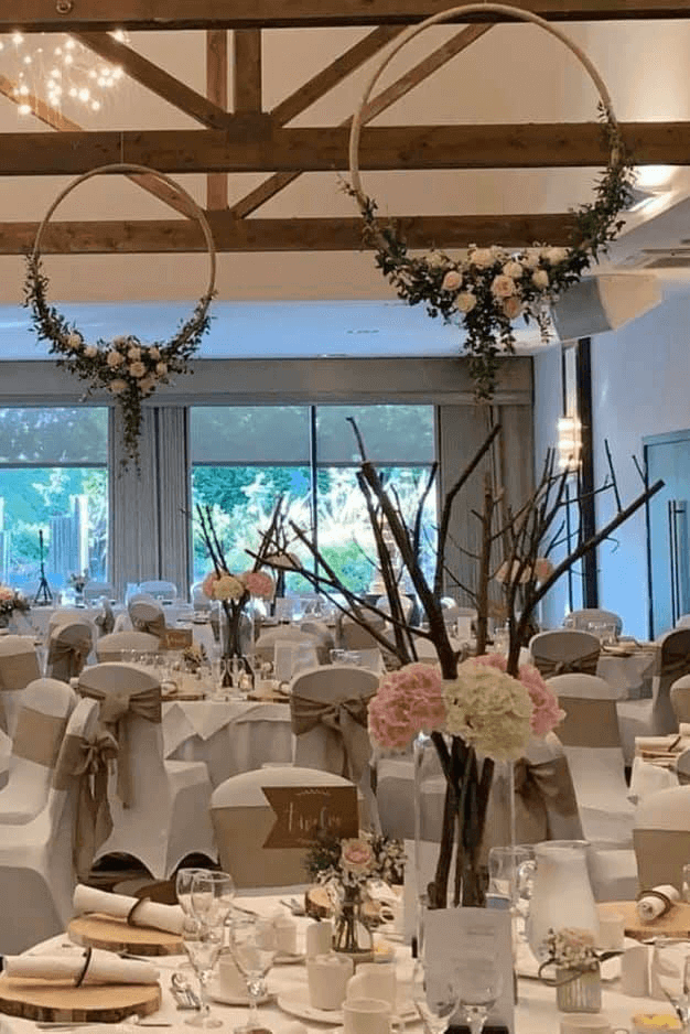 flowers on table with floral centrepieces hanging above